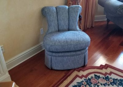 One of a pair of channel back chairs.